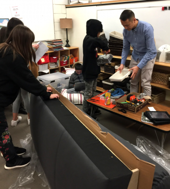 maker space with children and teachers constructing couch
