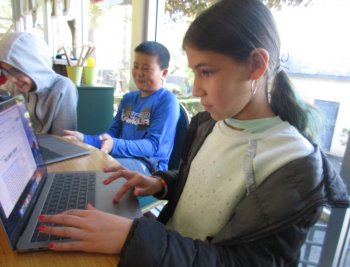students working on laptops in UCLA Lab School classroom