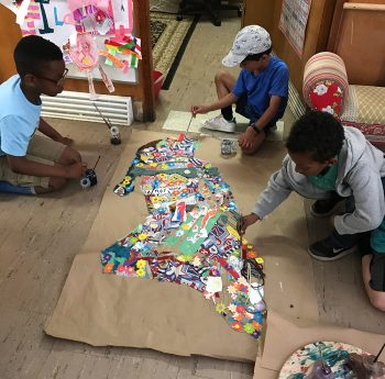 young boys working on collage artwork